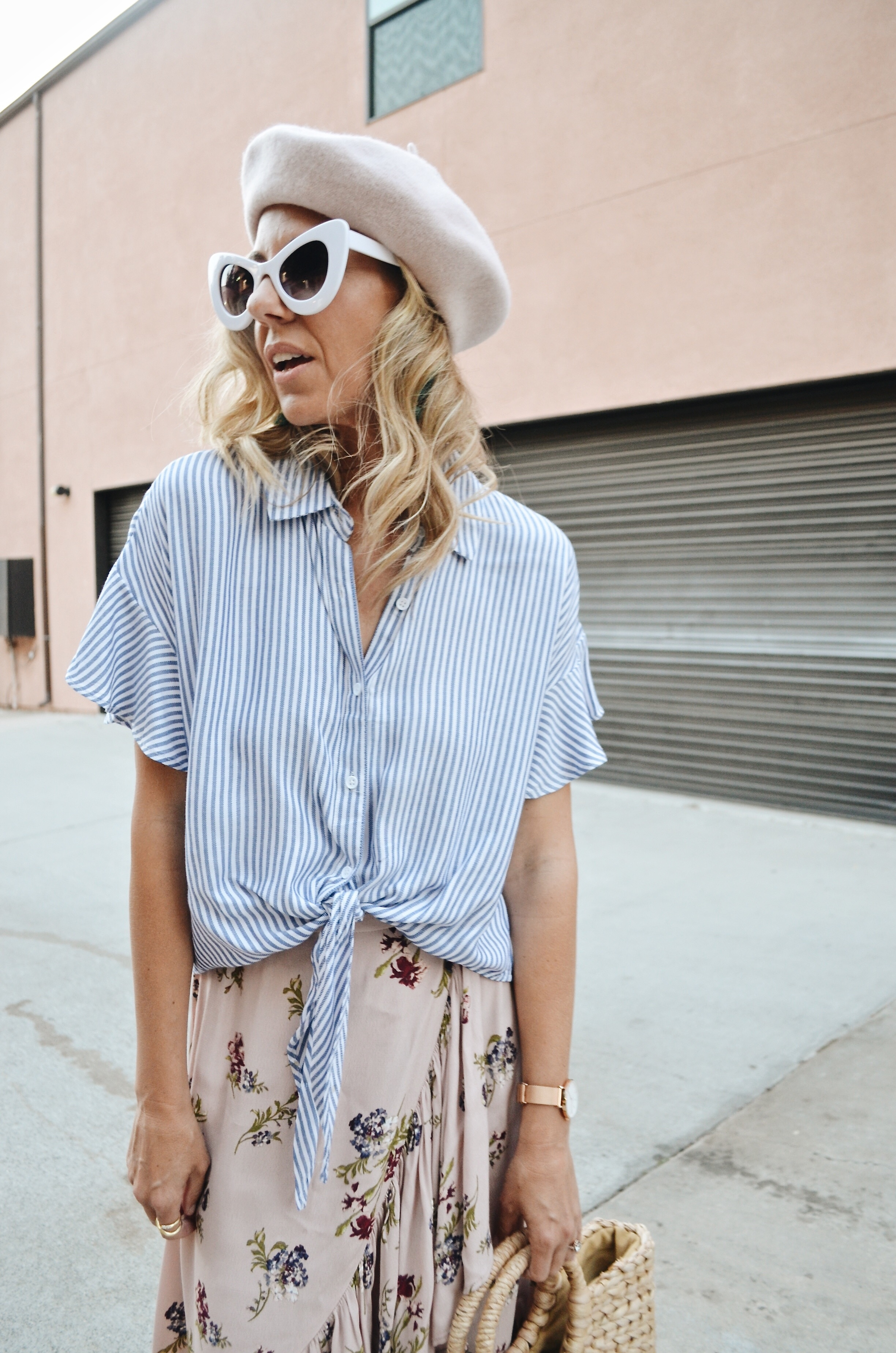 FLORAL + STRIPES - JACLYN DE LEON STYLE + striped top with ruffle sleeve + floral ruffle midi skirt + straw handbag + retro sunglasses + pink beret hat + spring outfit inspiration + street style