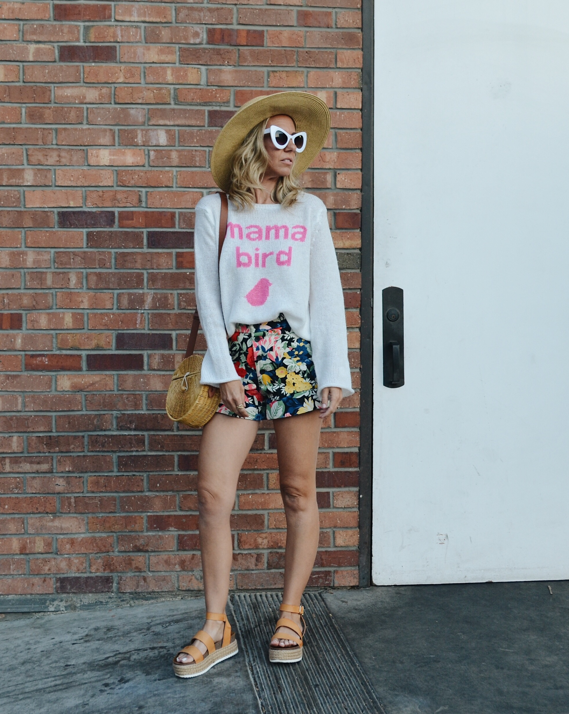 MAMA BIRD SWEATER + FLORAL RUFFLE SHORTS + STRAW BAG + STRAW HAT + RETRO STYLE SUNGLASSES + PLATFORM SANDALS
