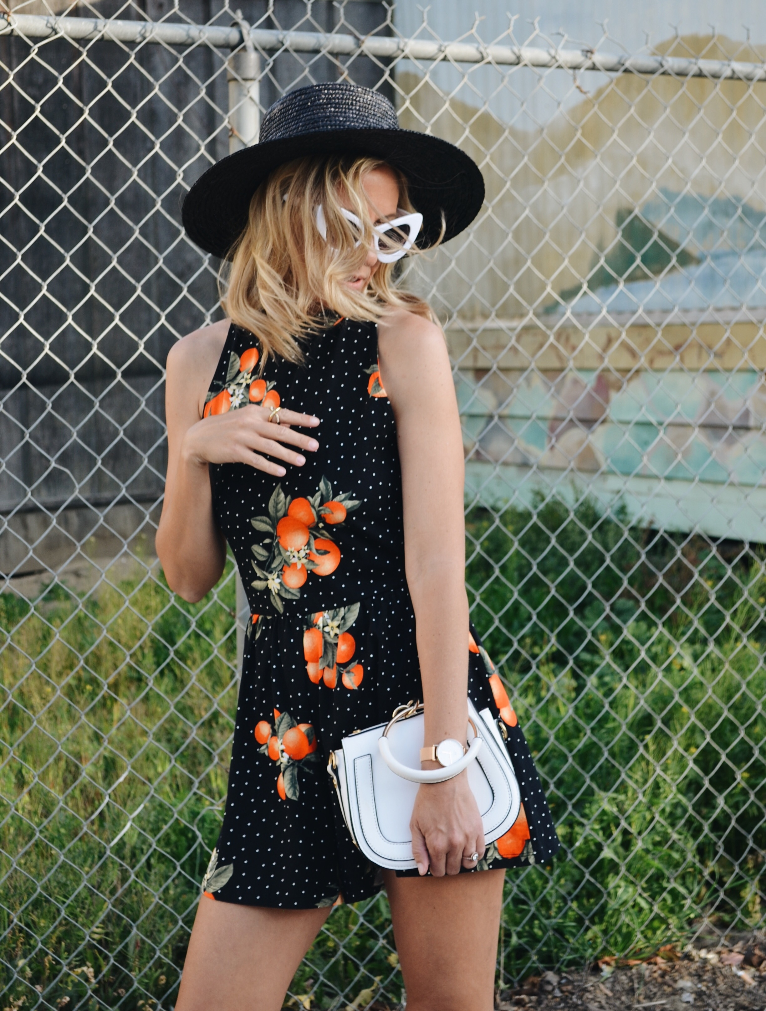 ORANGE ROMPER - Jaclyn De Leon Style - summer style + fruit inspired look + spring outfit + fun edgy street style + forever 21 + retro sunglasses + chloe dupe handbag + statement earrings