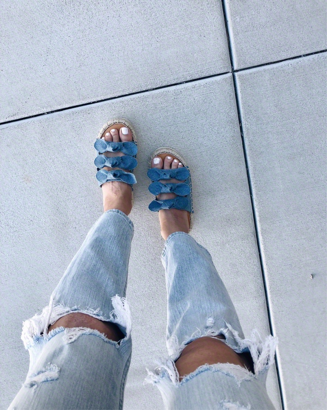 THE MUST HAVE SHOE TREND- PLATFORMS -Jaclyn De Leon Style + espadrille platforms + distressed denim + denim bow sandals + casual street style + what to wear this summer + American Eagle slip on sandals