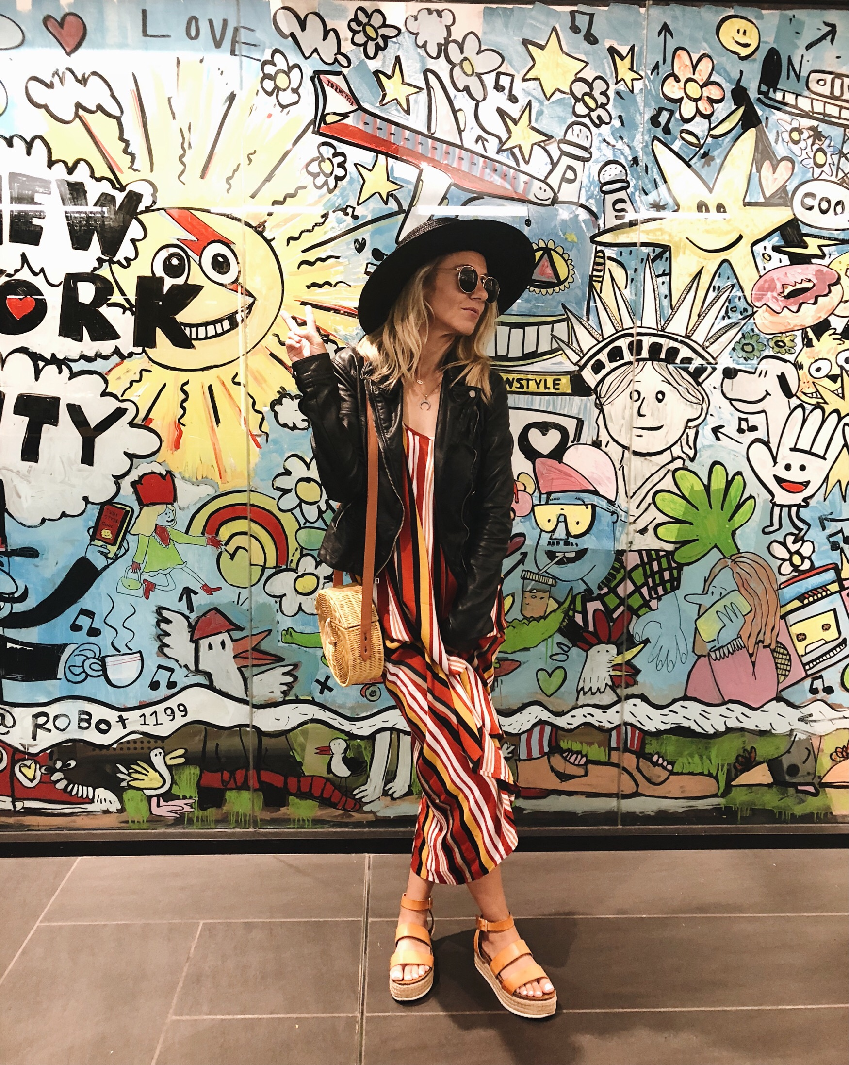 ADVENTURES IN NEW YORK- Jaclyn De Leon Style + striped maxi dress + faux leather jacket + forever 21 + platform sandals + black straw hat + straw crossbody bag + summer style + street style + what to wear in NY + boho chic