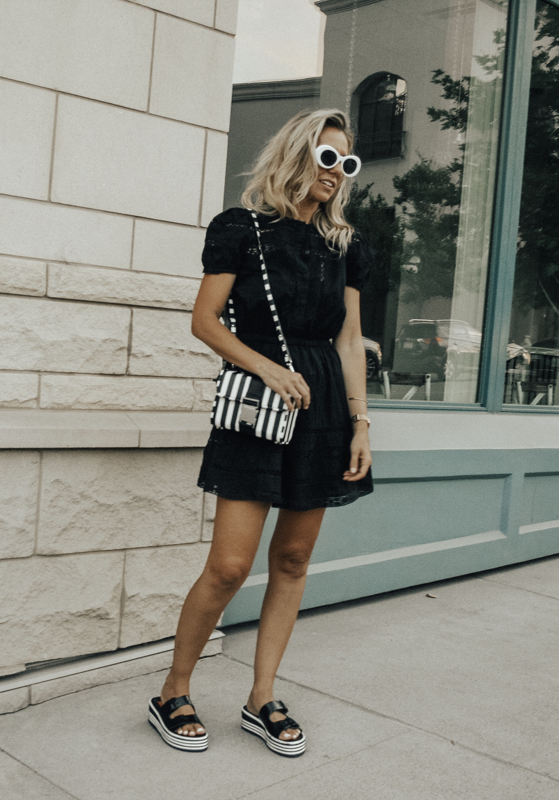 BLACK, WHITE + A LITTLE BIT RETRO- Jaclyn De Leon Style + black lace dress + black and white striped crossbody handbag + platform sandals + retro style sunglasses + urban outfitters + Zara handbag + boho chic street style + summer outfit + style inspiration