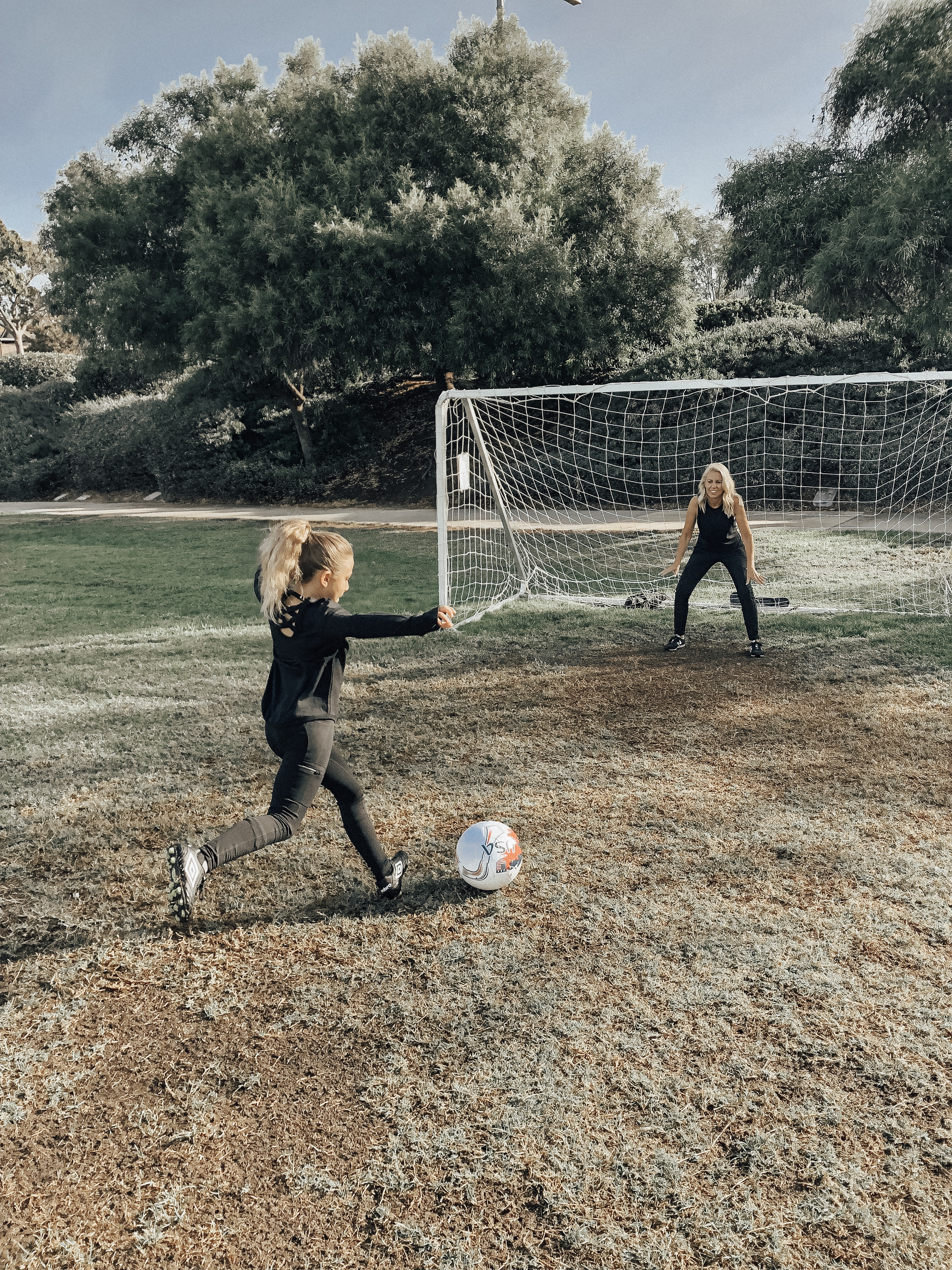 STAYING ACTIVE WITH ATHLETA- Jaclyn De Leon Style + Mommy and me matching looks + active wear + soccer + sports + momlife + stretching + black chic athletic wear