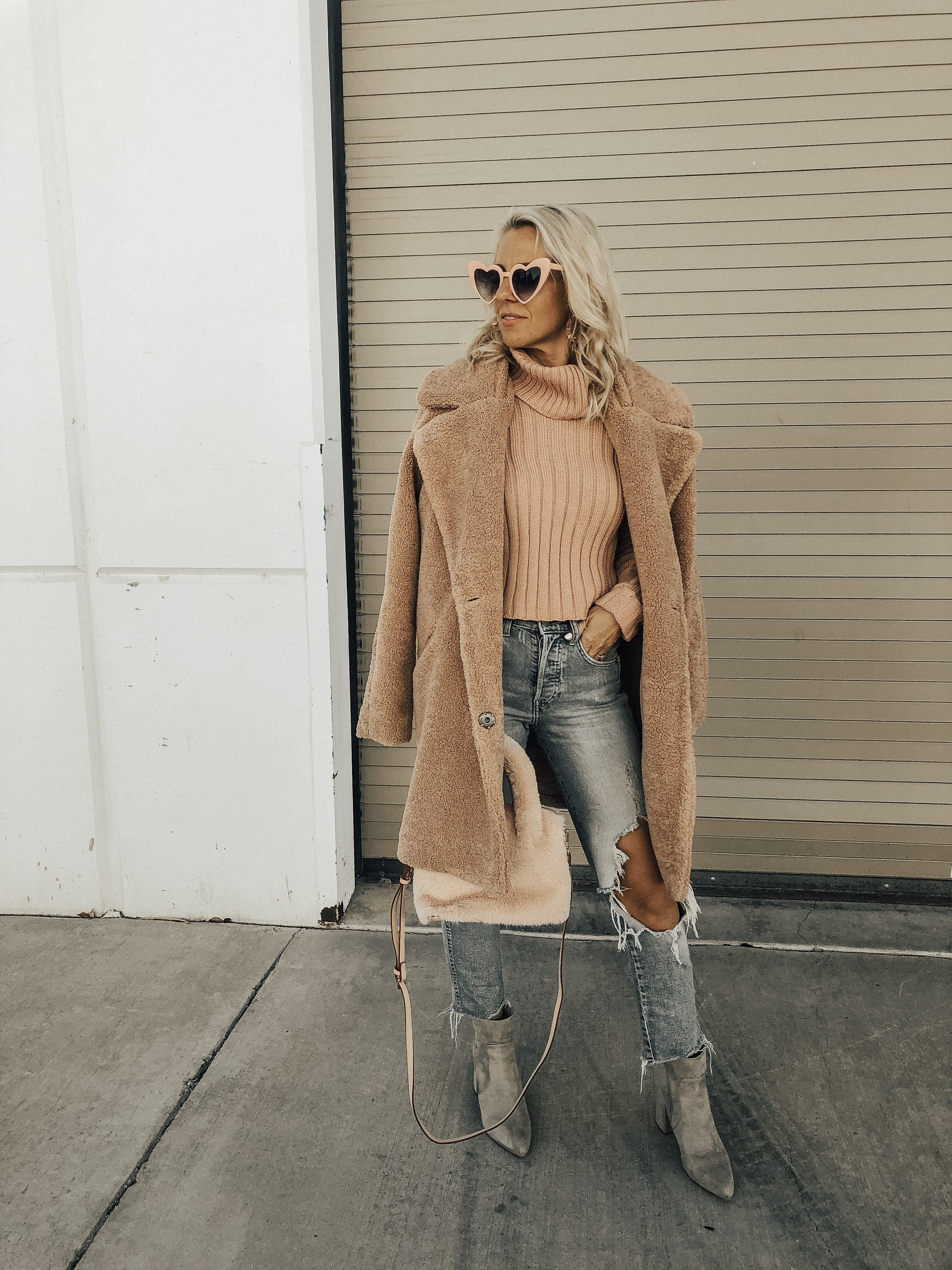THINK PINK- Jaclyn De Leon Style + pink for October + cozy tutleneck sweater + teddy coat + distressed denim + pink faux fur handbag + heart sunglasses + casual style + fall fashion + street style + mom style + what to wear this season + winter outfit