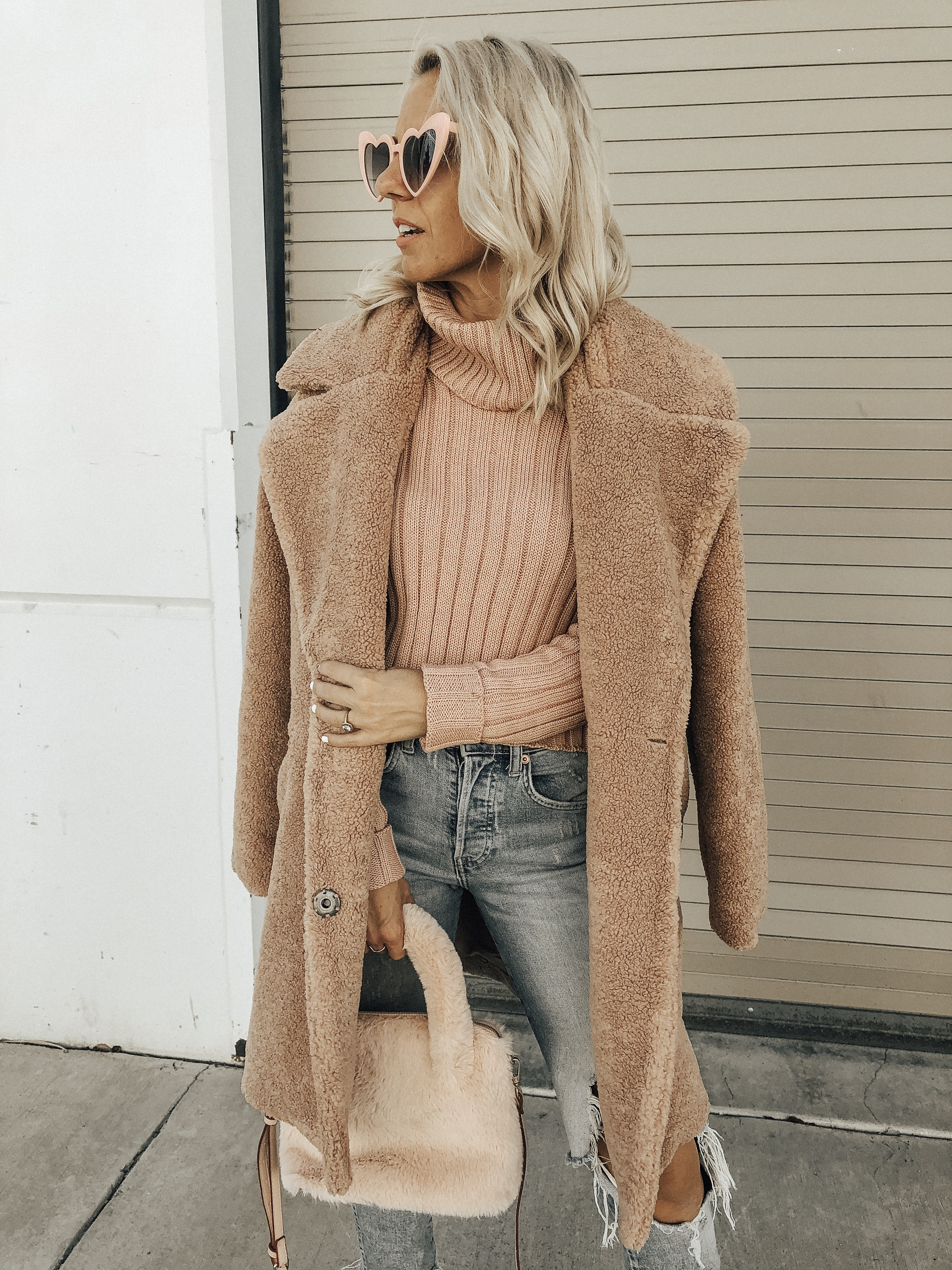 OCTOBER TOP 10- Jaclyn De Leon Style + pink for October + cozy tutleneck sweater + teddy coat + distressed denim + pink faux fur handbag + heart sunglasses + casual style + fall fashion + street style + mom style + what to wear this season + winter outfit