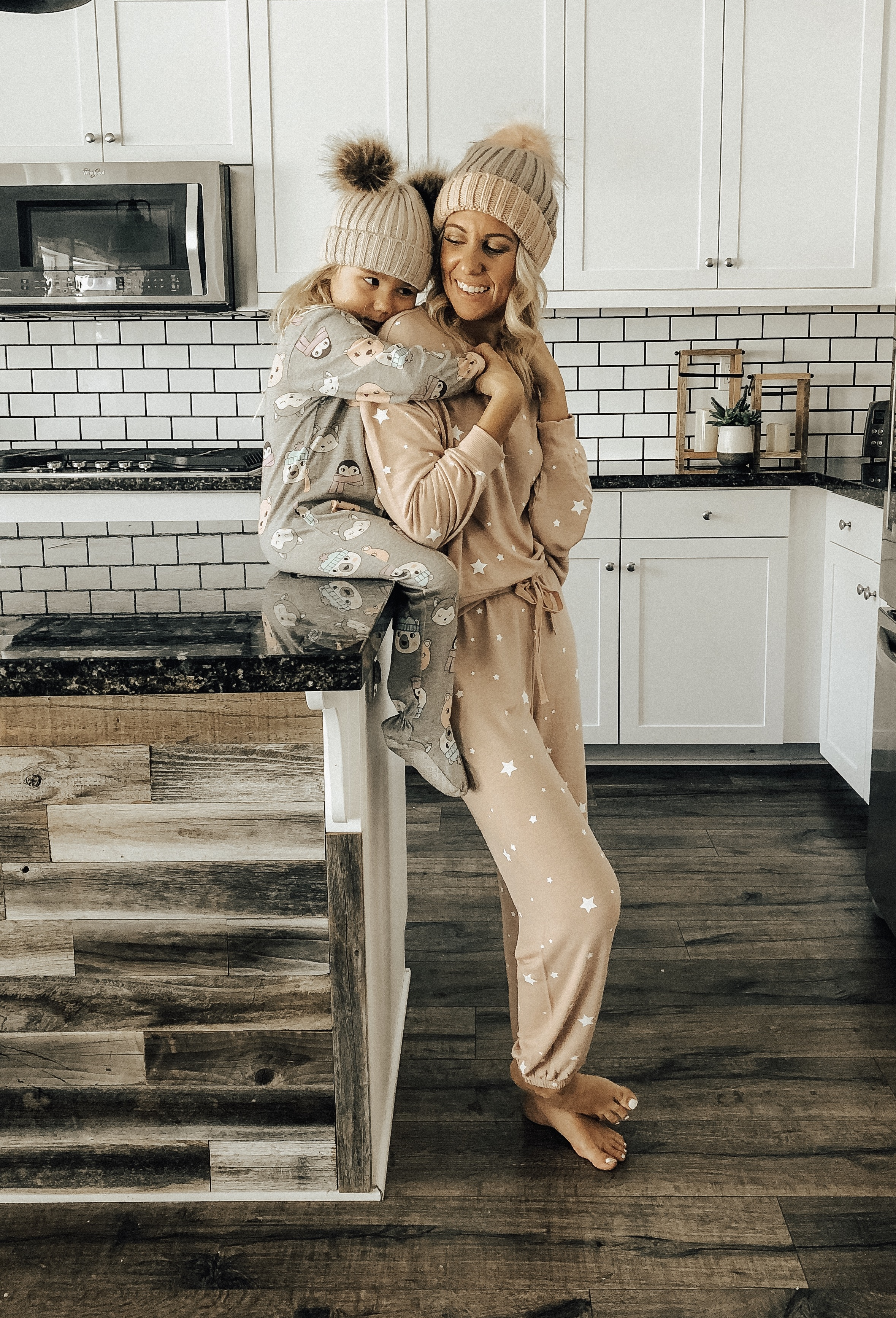THE COZY GIFT GUIDE- Jaclyn De Leon Style + mommy and me pajamas + pom pom beanies + star print matching set + z supply + pajama onesie + target style + mom style + casual style + holiday matching looks + cozy
