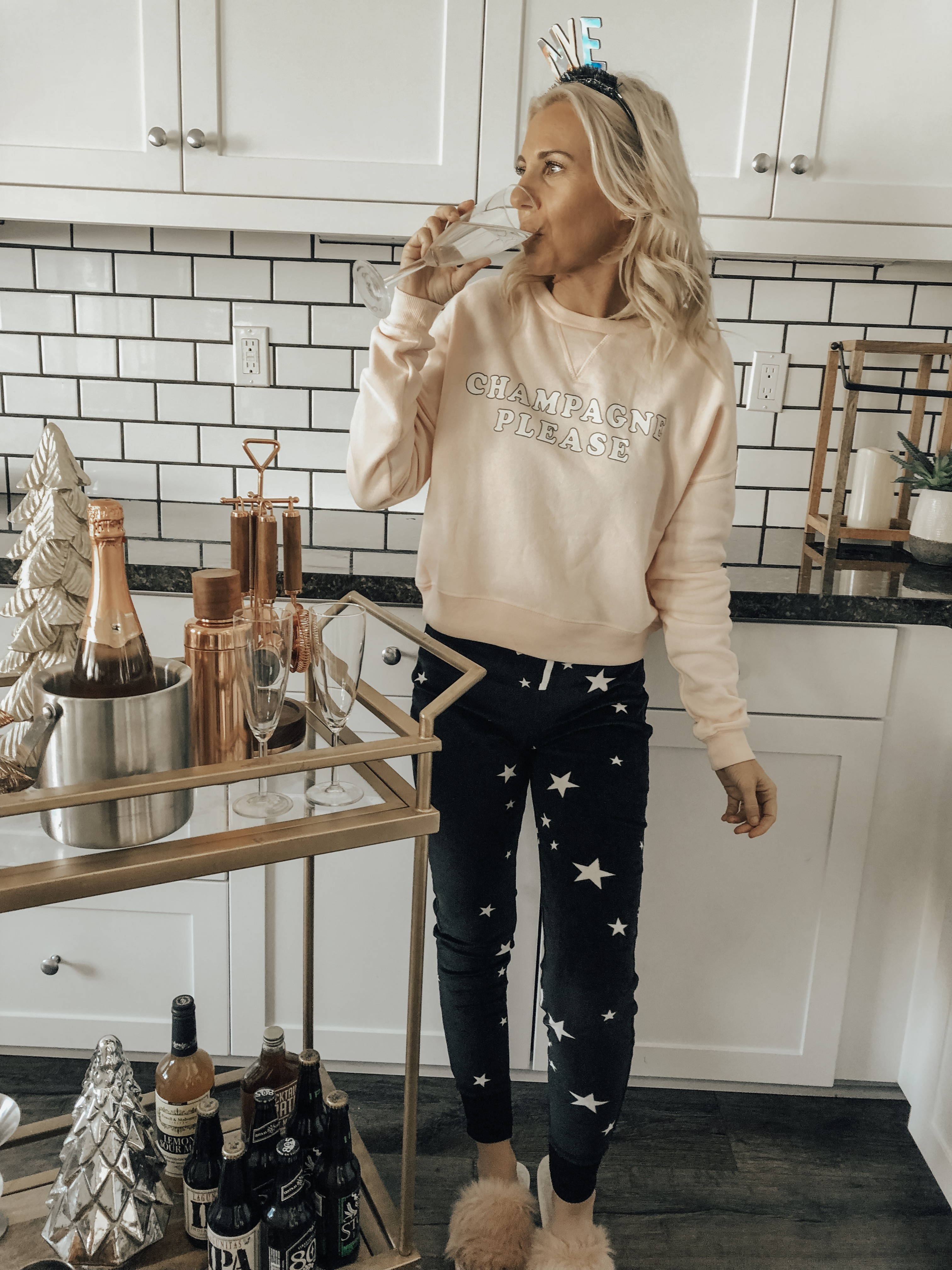A COZY & CASUAL NYE- Jaclyn De Leon Style + New Years 2019 + casual sweatshirt + star print jogger pants + champagne please + target style + bar cart + party supplies + cozy home + party planning + lounging at home + countdown to New Years