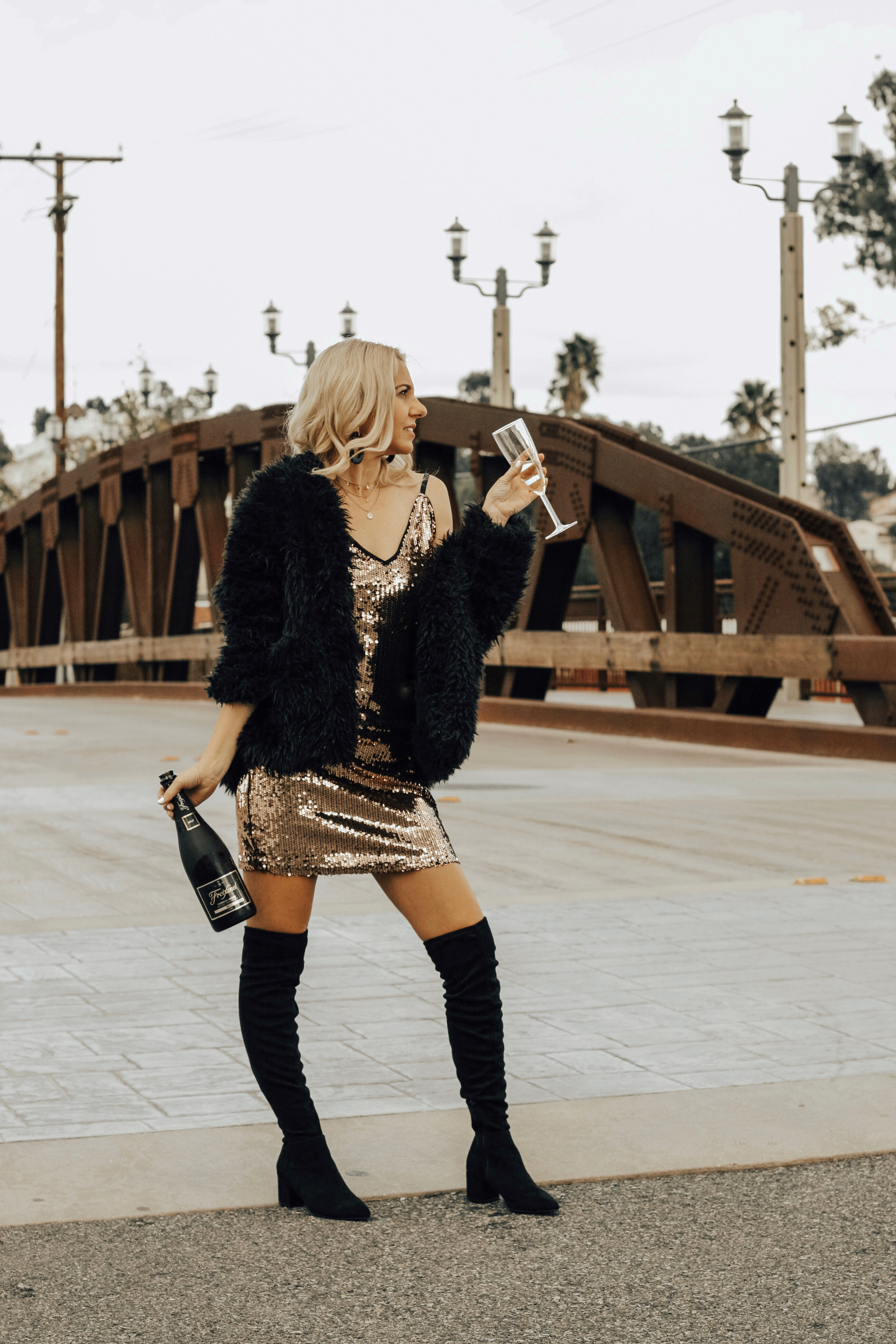 NYE PARTY LOOKS- Jaclyn De Leon Style + New Years Eve party dress + champagne + celebrate + street style + party outfit + sequin dress + cocktail dress + winter style + OTK boots + target style + affordable fashion + mom style + cozy faux fur jacket + mini dress