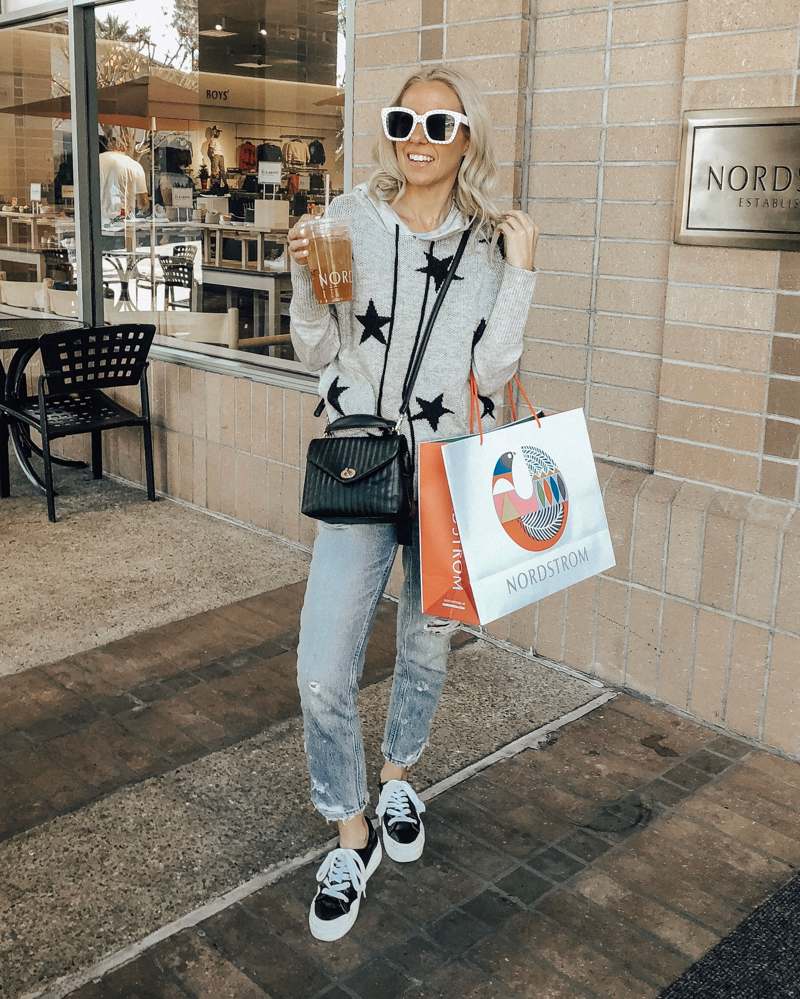 NORDSTROM'S HALF-YEARLY SALE PICKS- Jaclyn De Leon Style + online shopping + casual style + nordstrom + after christmas shopping + mom style + star print sweater + high waisted mom jeans + sneakers + sole society handbag + retro style sunglasses + sale picks + winter street style