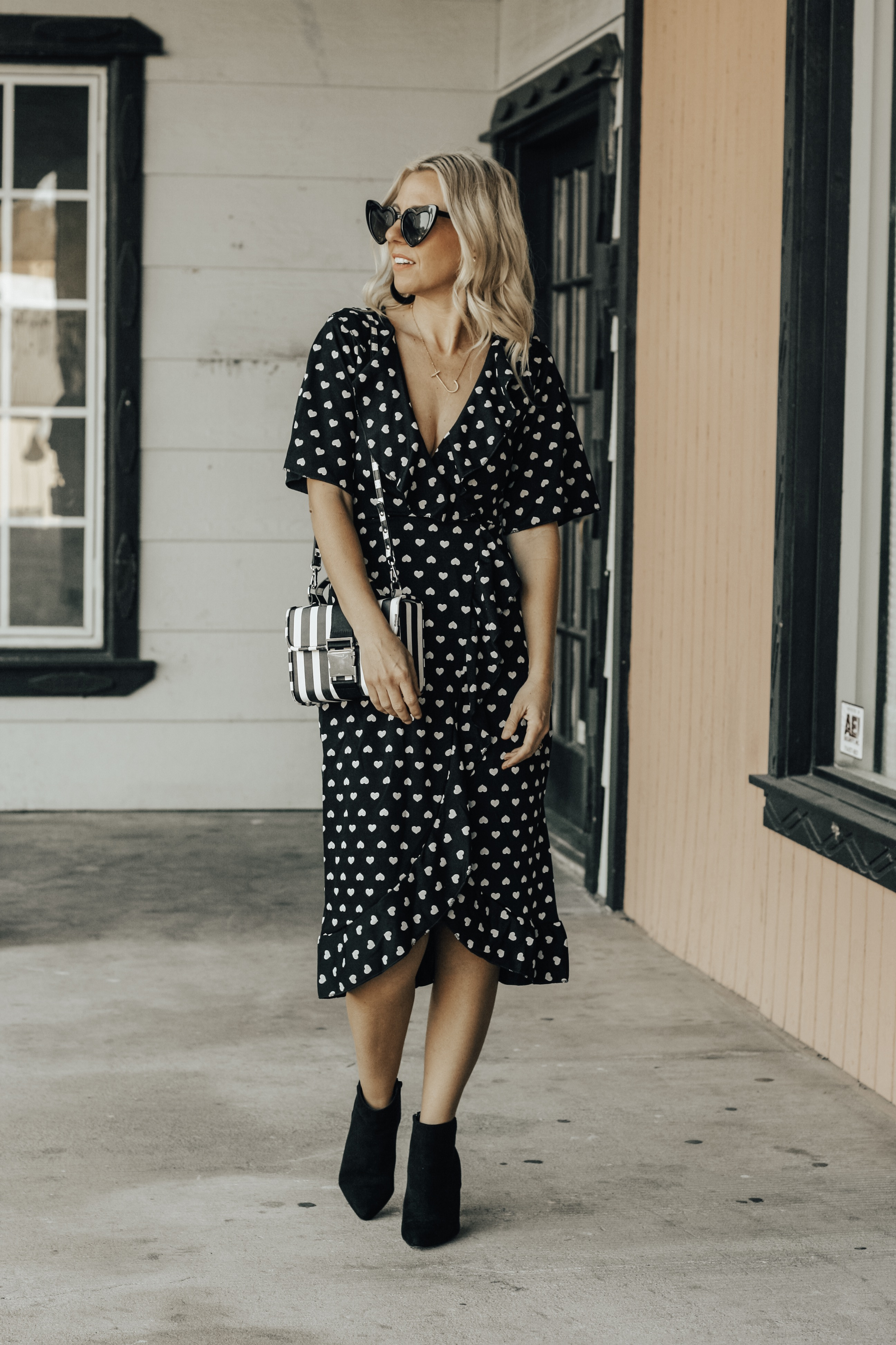 TWO VALENTINE'S DATE NIGHT LOOKS- Jaclyn De Leon Style + heard midi dress + black and white outfit + Valentine outfit inspo + asos + black booties + heart sunglasses + striped handbag + ruffle dot baby doll dress + abercrombie + faux fur jacket + stilettos + girls night out + dress up + spring street style
