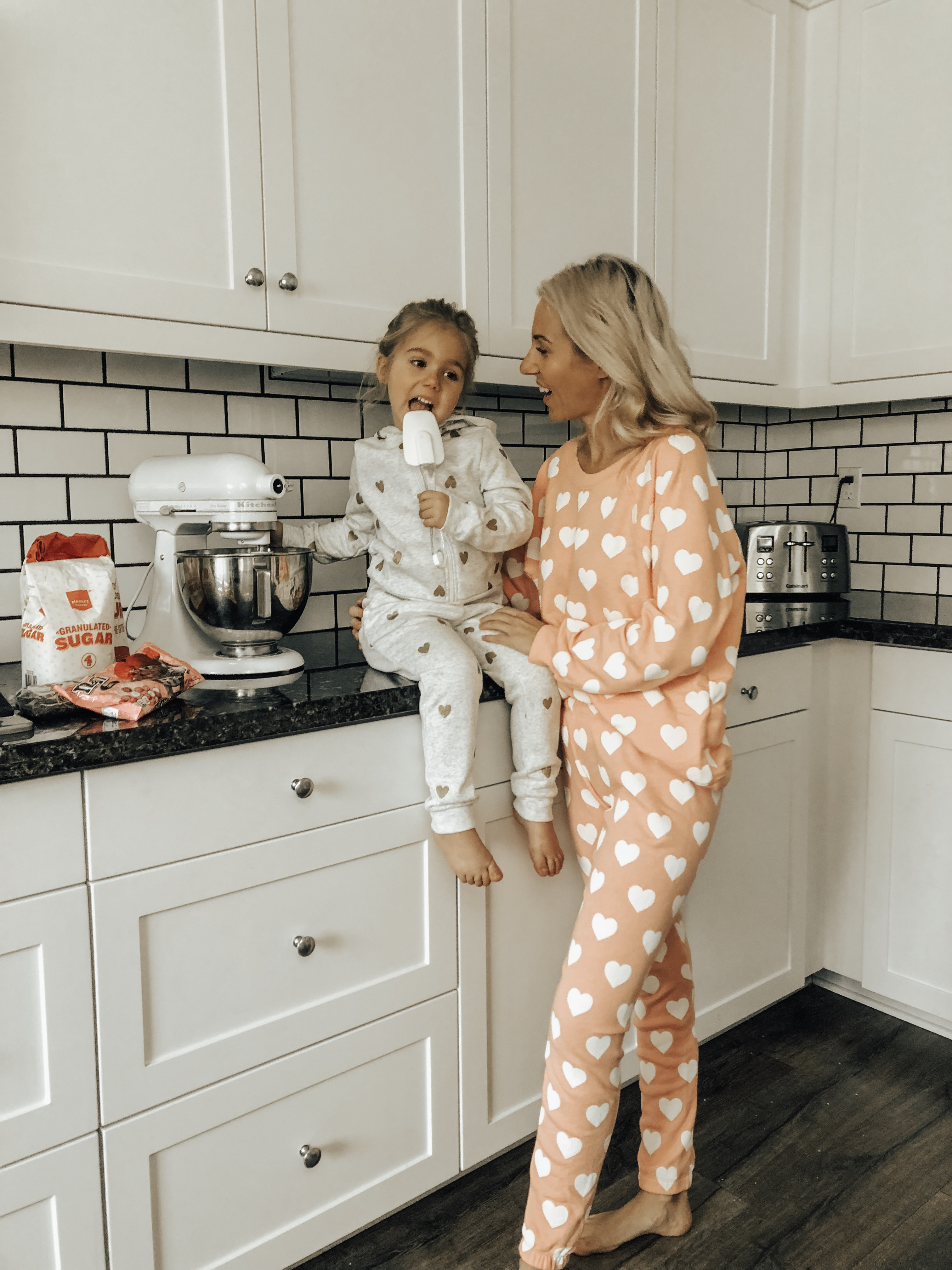 COZY & CASUAL VALENTINES AT HOME- Jaclyn De Leon Style + mommy and me making cookies + valentines inspired outfits + heart matching sets + pink + mini me + mom style + matching pajamas + at home making cookies + in the kitchen + matching outfits + mom life + kid style + nordstrom rack + h&m style